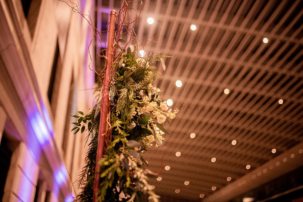wedding arch with florals on the aisle of cleveland museum of art