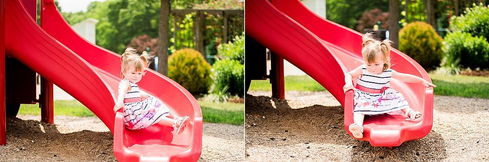 Little girl slides down a slide