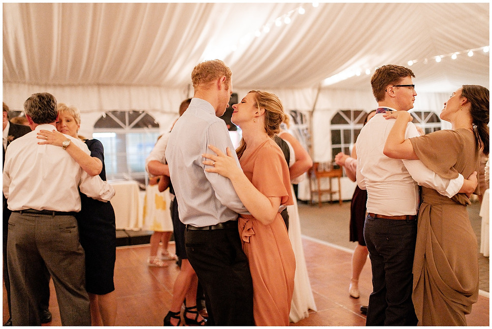two guests dance at wedding reception