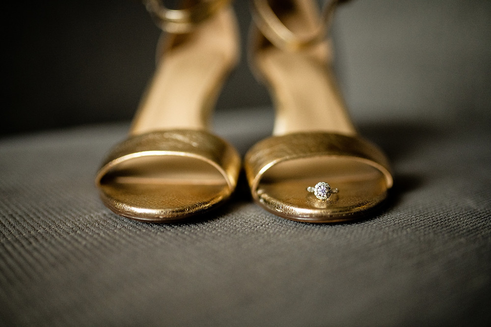 Engagement ring on bride's gold shoes at the Westin Cleveland