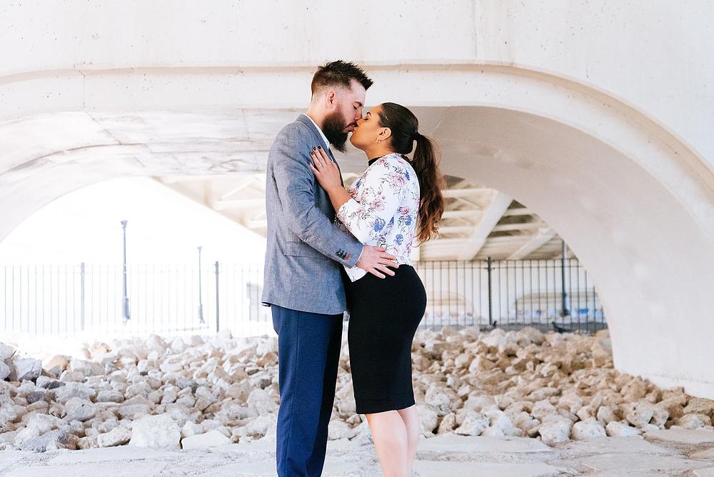 Man and woman kiss underneath bridge near Ohio City, Cleveland, Ohio