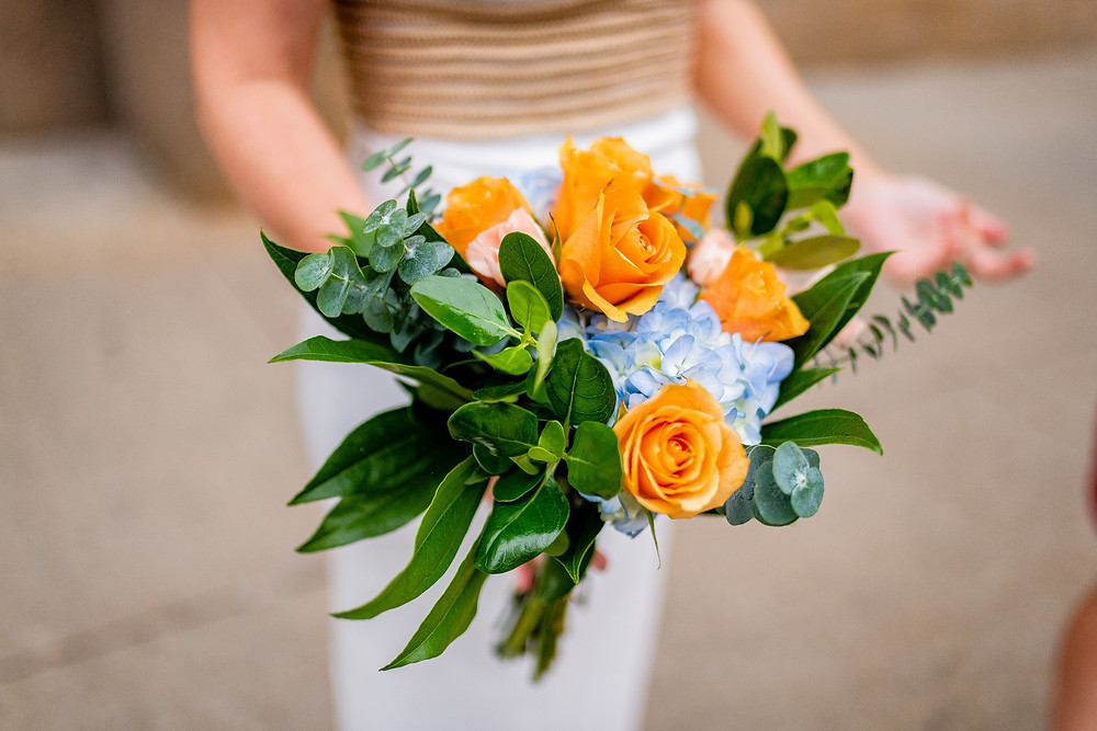 bridal bouquet with orange and blue flowers in the flats of cleveland ohio
