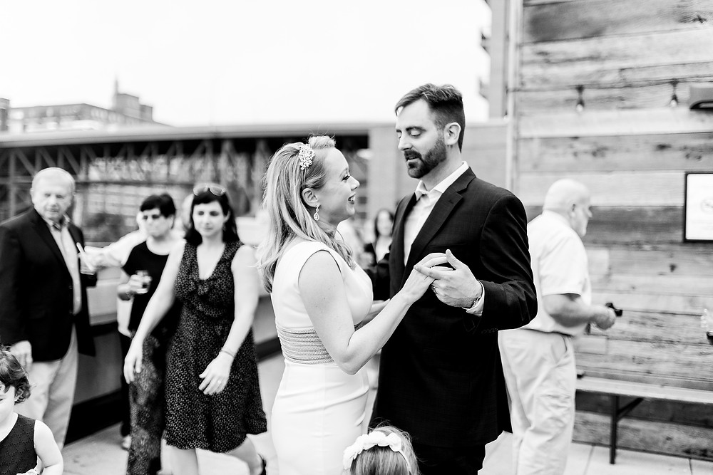 bride and groom slow dance on rooftop of punch bowl social of cleveland ohio