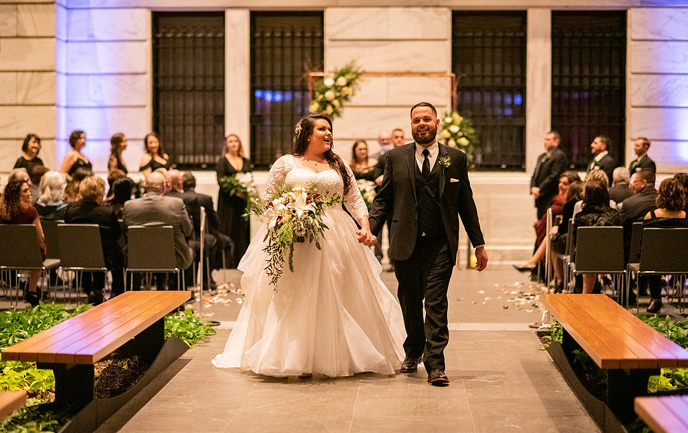 bride and groom during wedding recessional at the cleveland museum of art