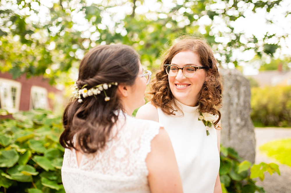 bride and bride portraits outside by trees