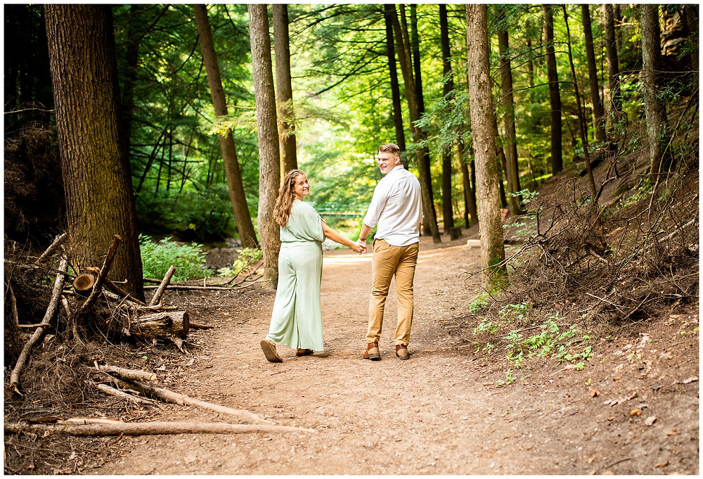 engagement photo of man and woman in hocking hills state park trails