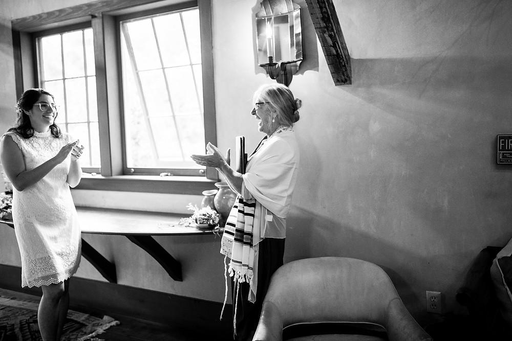 rabbi claps after ketubah signing