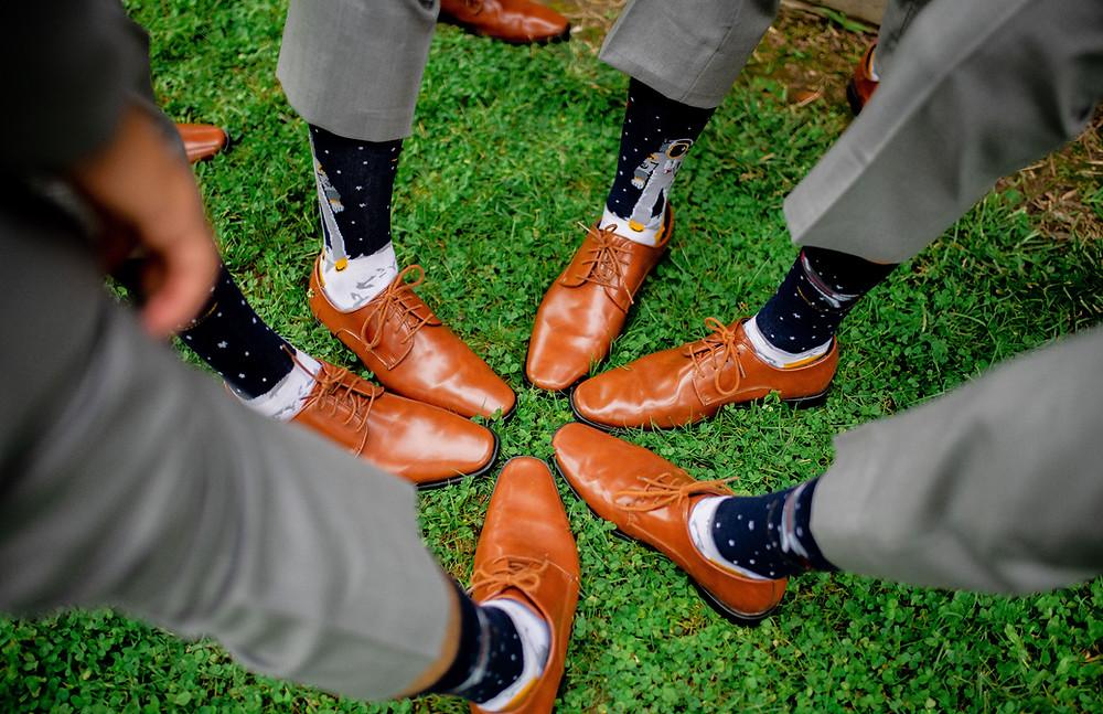 Groomsmen show off their socks near Cleveland, Ohio
