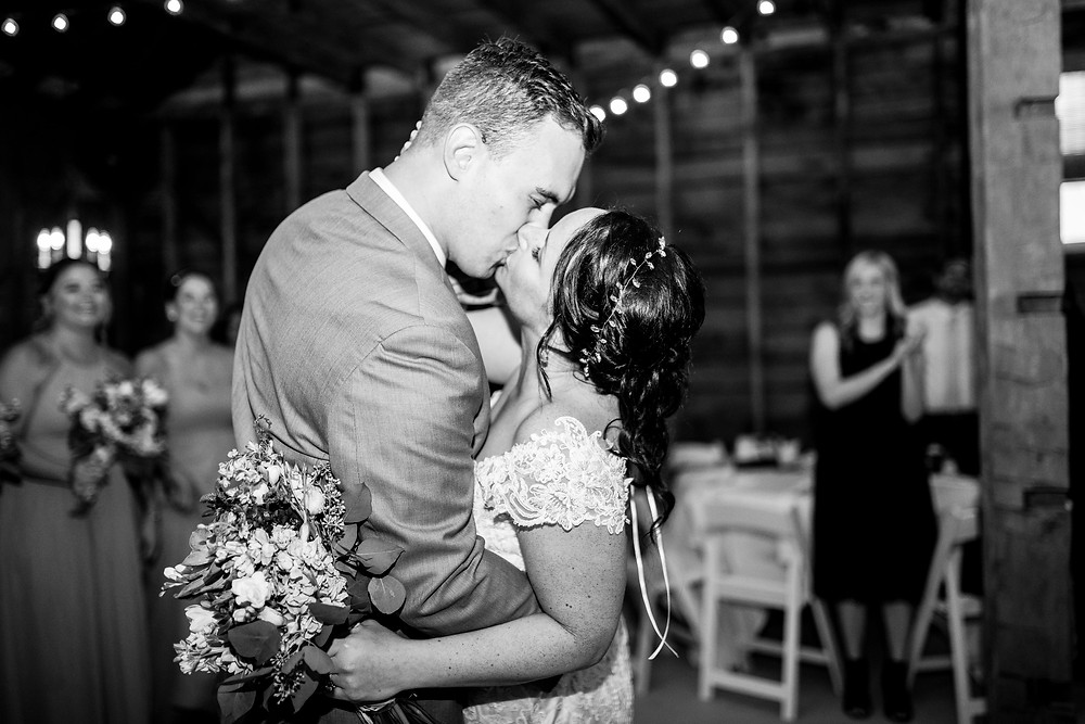 bride and groom kiss during reception at hillcrest fun farm in northeast Ohio