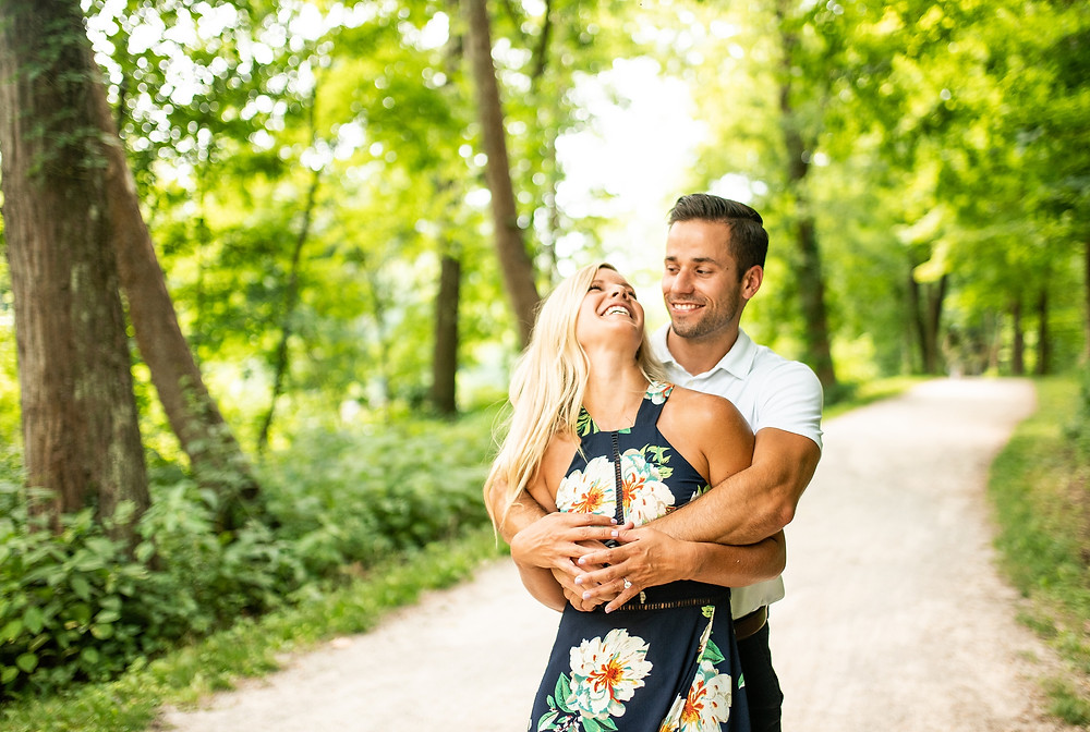 Man and woman hug and laugh out loud as they stand on the Cuyahoga Valley National Park towpath