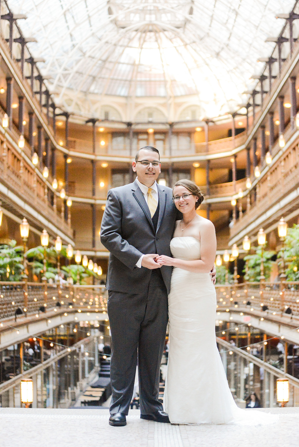 Bride and groom standing in the Cleveland Arcade in downtown Cleveland