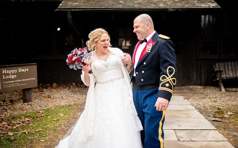 bride and groom smile and laugh with one another at the happy days lodge venue in peninsula ohio