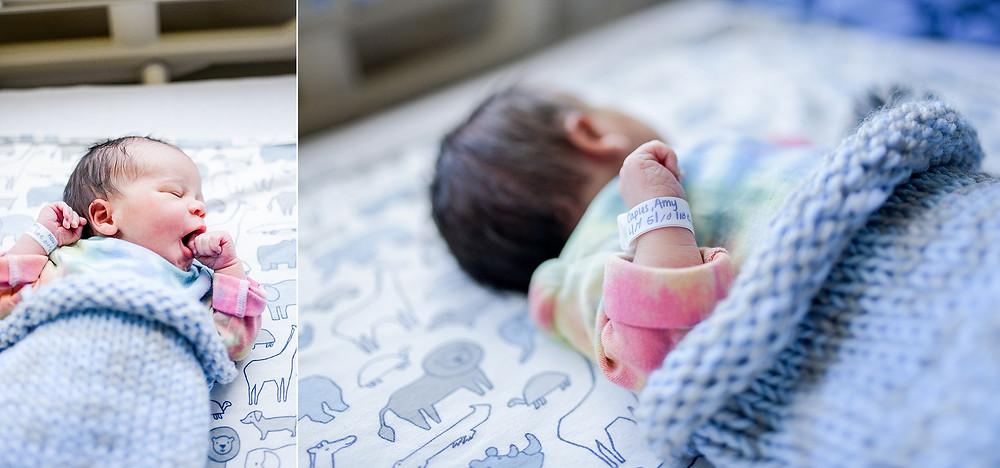 Newborn baby in yarn blanket during Fresh 48