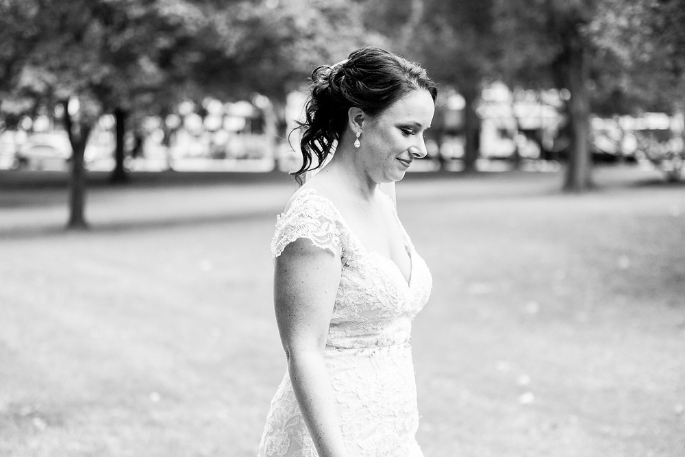 Bride walks towards groom during first-look near Cleveland, Ohio