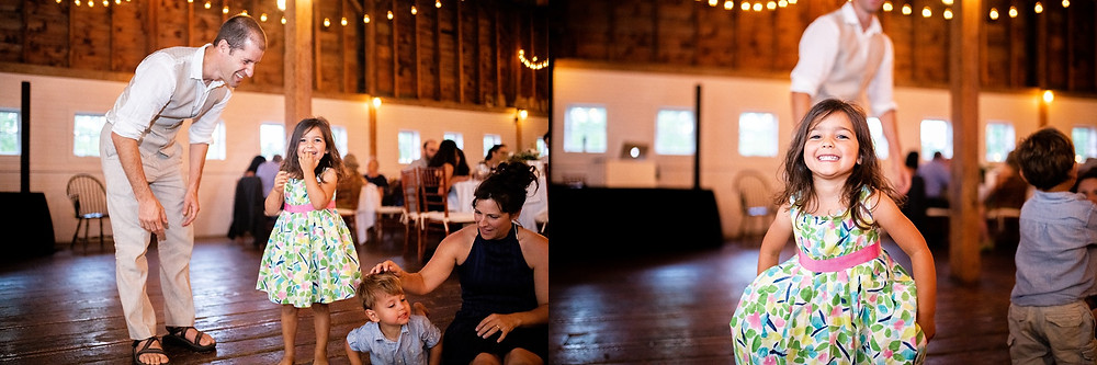 little girl and boy dance during reception