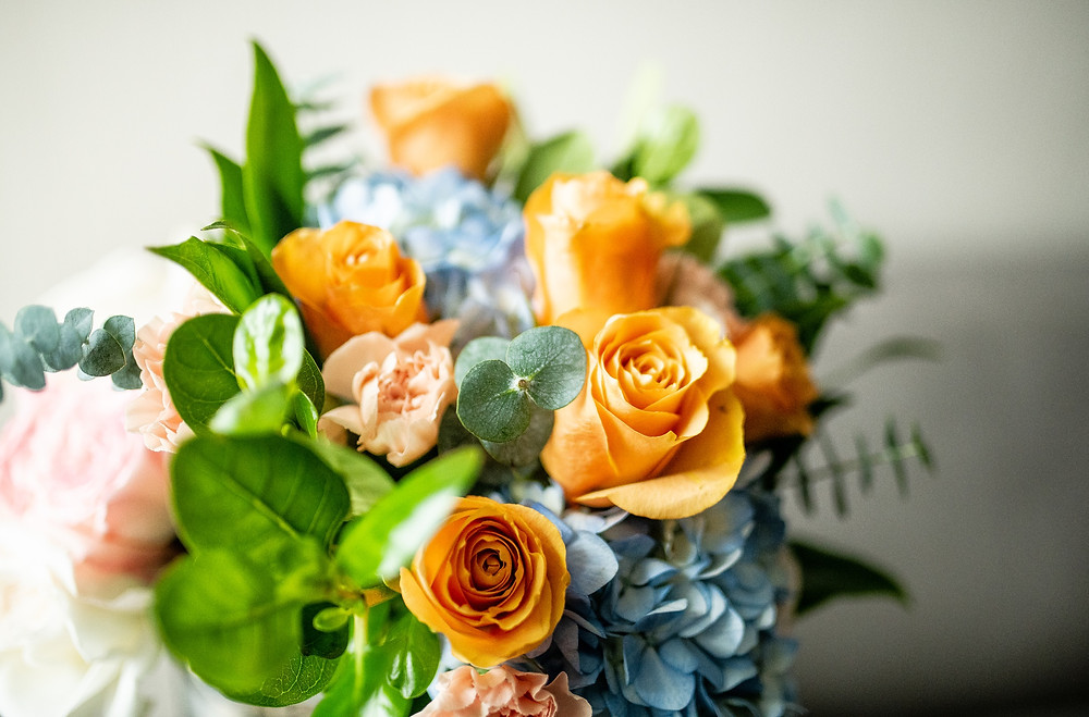 Bridal bouquet of orange roses and blue hydrangeas at the Westin Cleveland