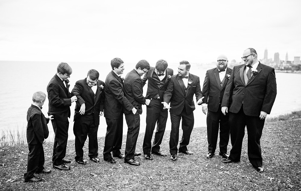 groomsmen stand for photo in cleveland ohio near edgewater park