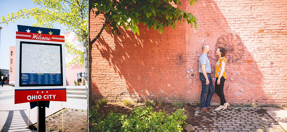 The official Ohio City sign with husband and wife standing near a brick wall