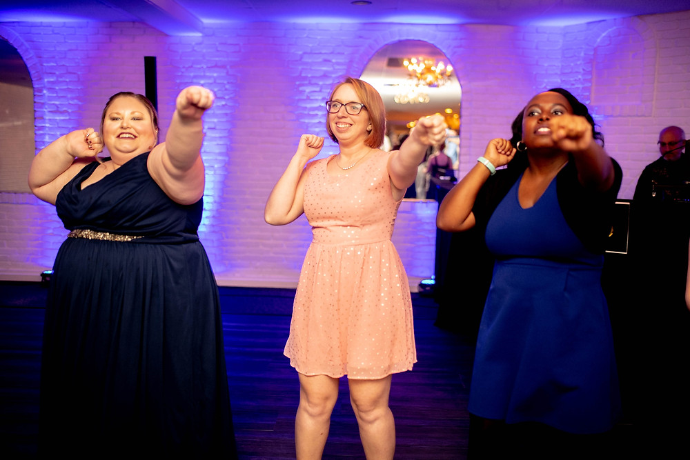wedding guests dance and cheer the bowling green state university fight song
