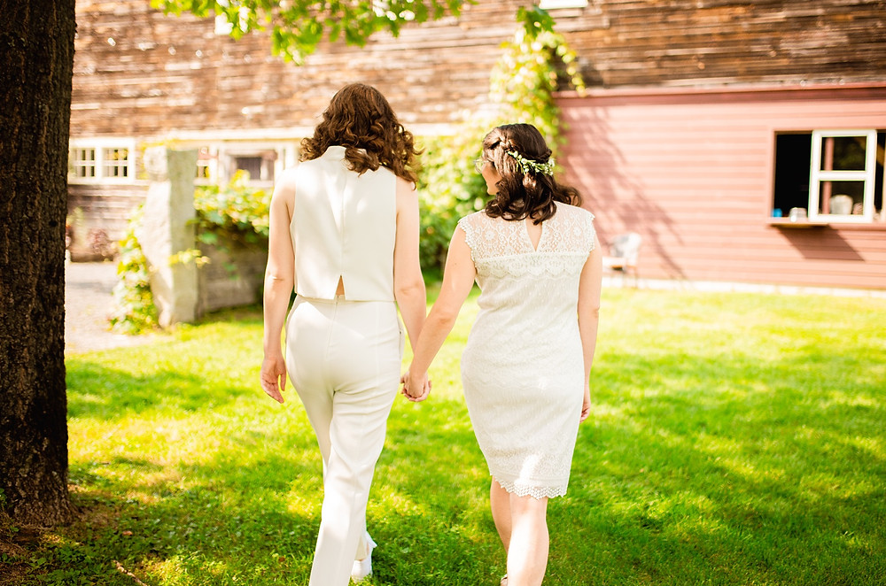 bride and bride hold hands and walk together