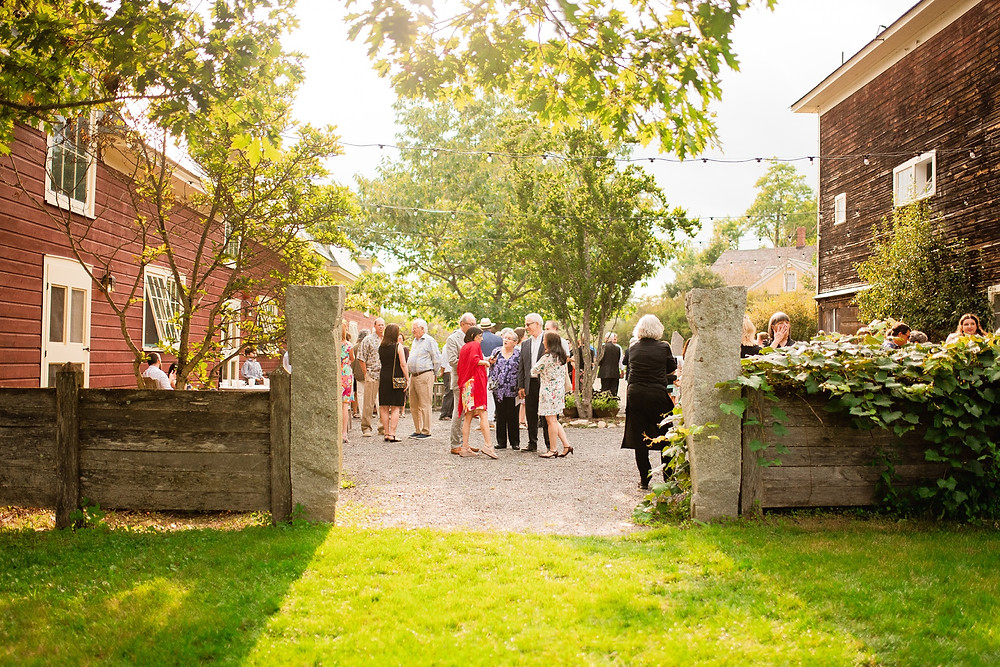 guests arrive for ceremony at rustic venue