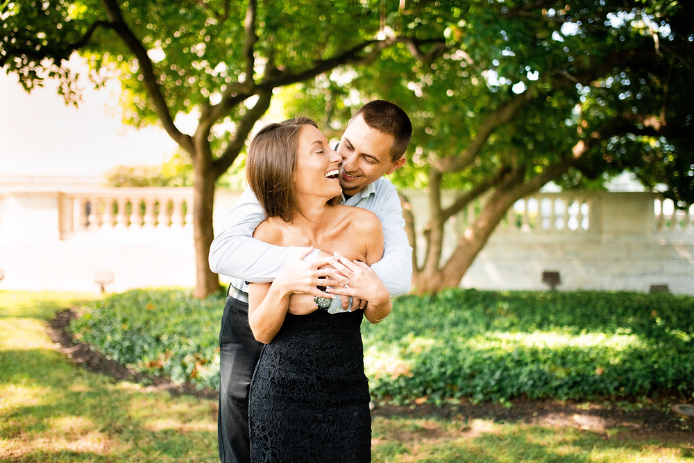 Woman and man giggle during engagement session at Cleveland, Ohio University Circle