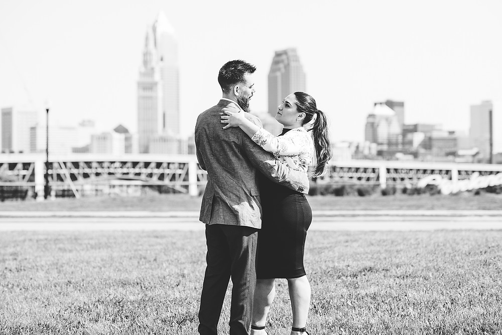 Man and woman dance together in front of the Cleveland, Ohio skyline