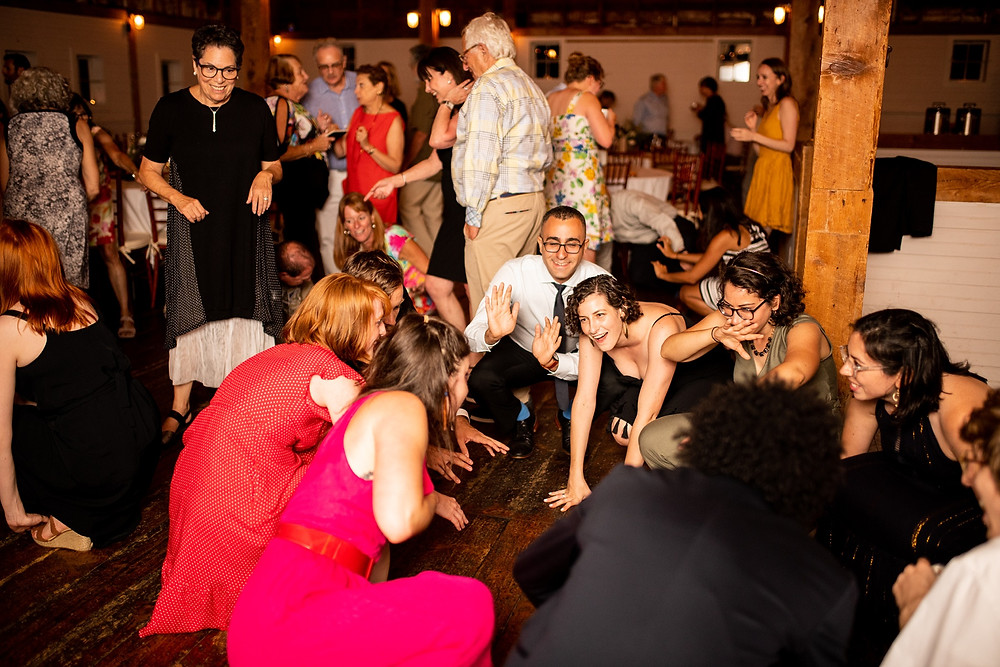 group of friends dances during the wedding reception