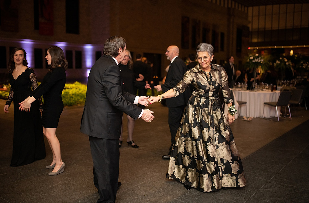 mother of the bride dancing at wedding reception at the cleveland museum of art