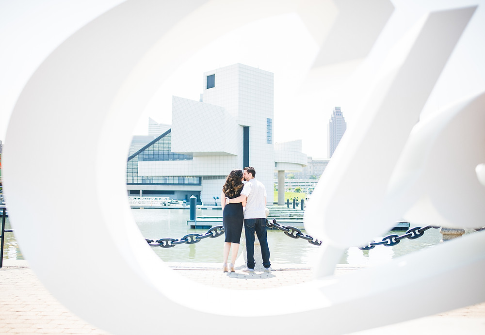 Man and woman kiss in Voinovich Bicentennial Park