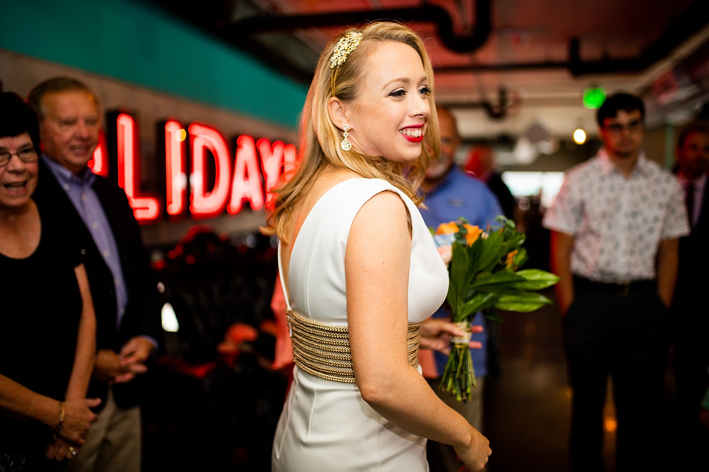 bride smiles during reception at cleveland ohio venue punch bowl social