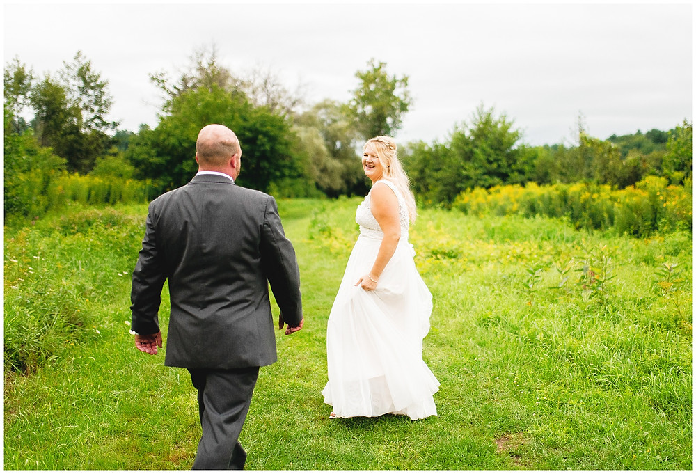 bride and groom laugh and chase each other
