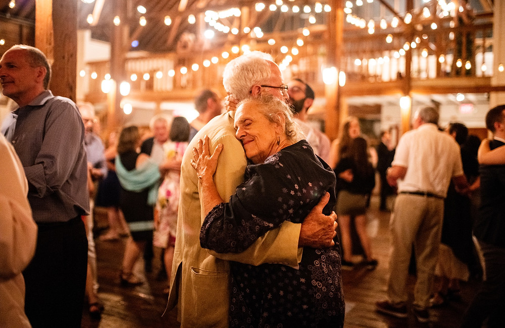 couple embraces during slow dance at wedding reception