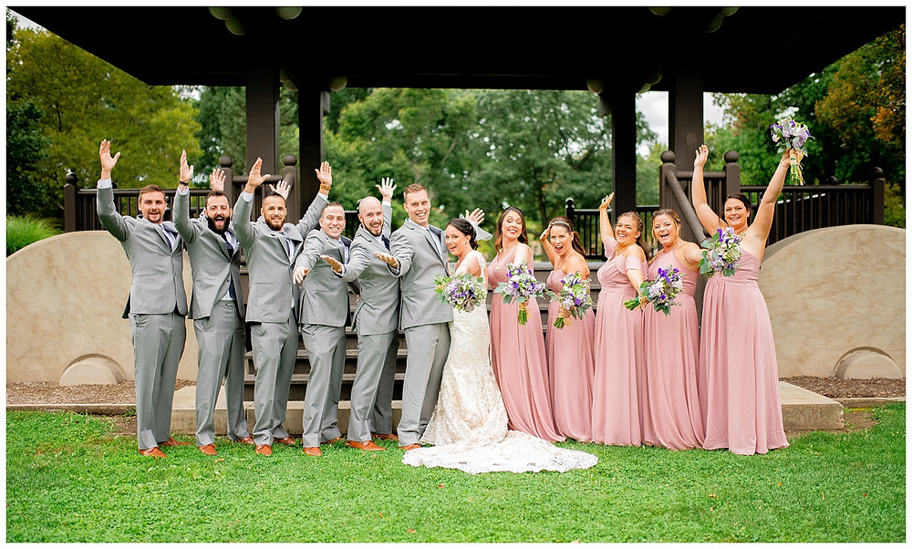 Bridal party cheers near gazebo on Oberlin College's campus