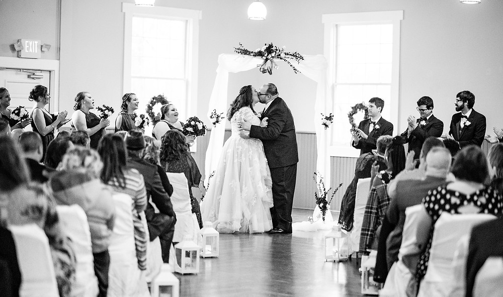 bride and groom kiss on alter at cleveland ohio wedding