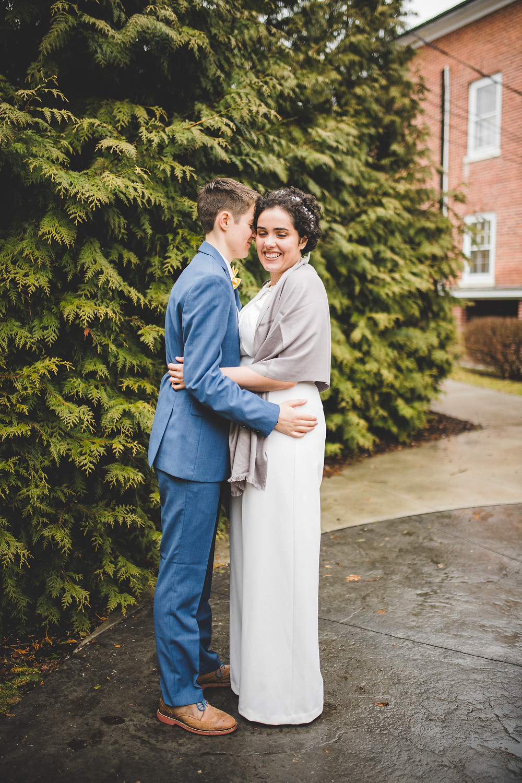 brides embrace after wedding ceremony
