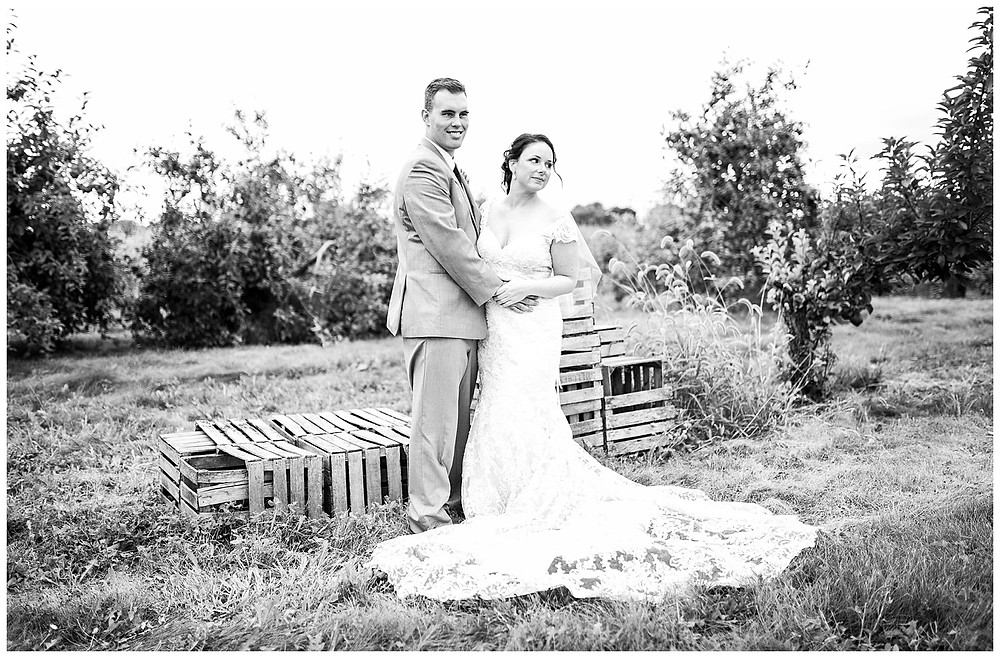 bride and groom embrace in an apple orchard near amherst Ohio