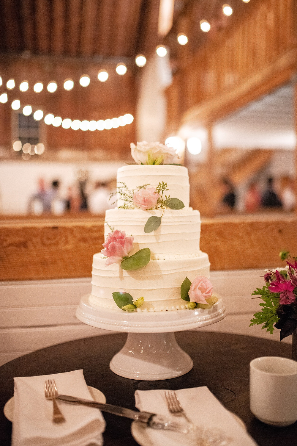 cake with roses and string lights