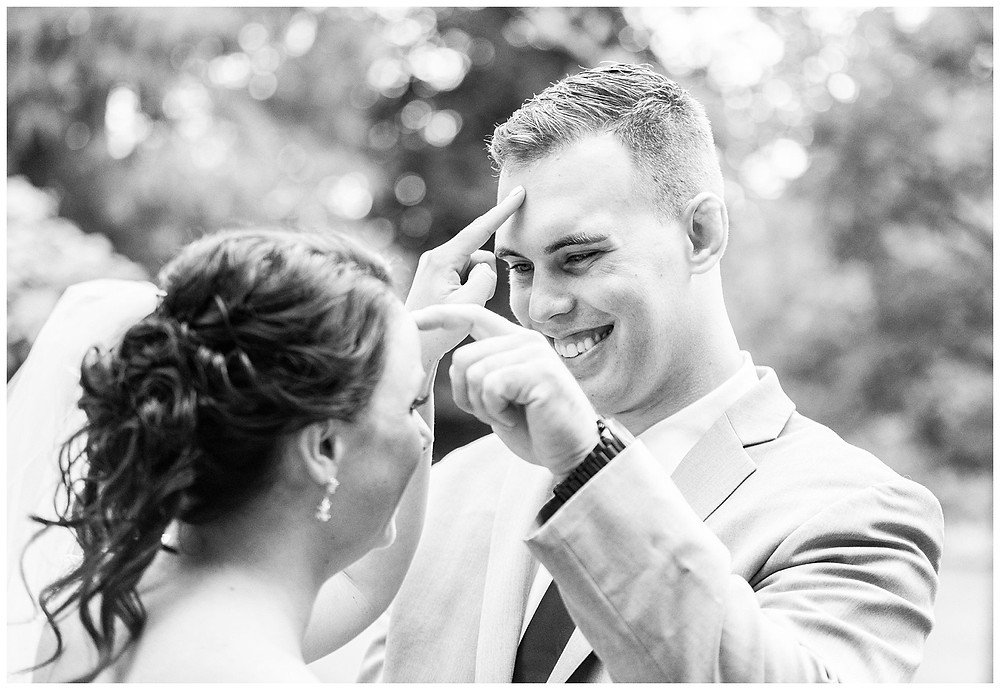 bride and groom joke around during their first-look near Cleveland, Ohio