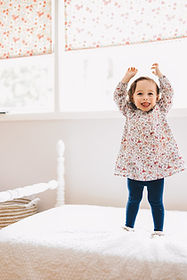 fun and silly toddler jumping on bed