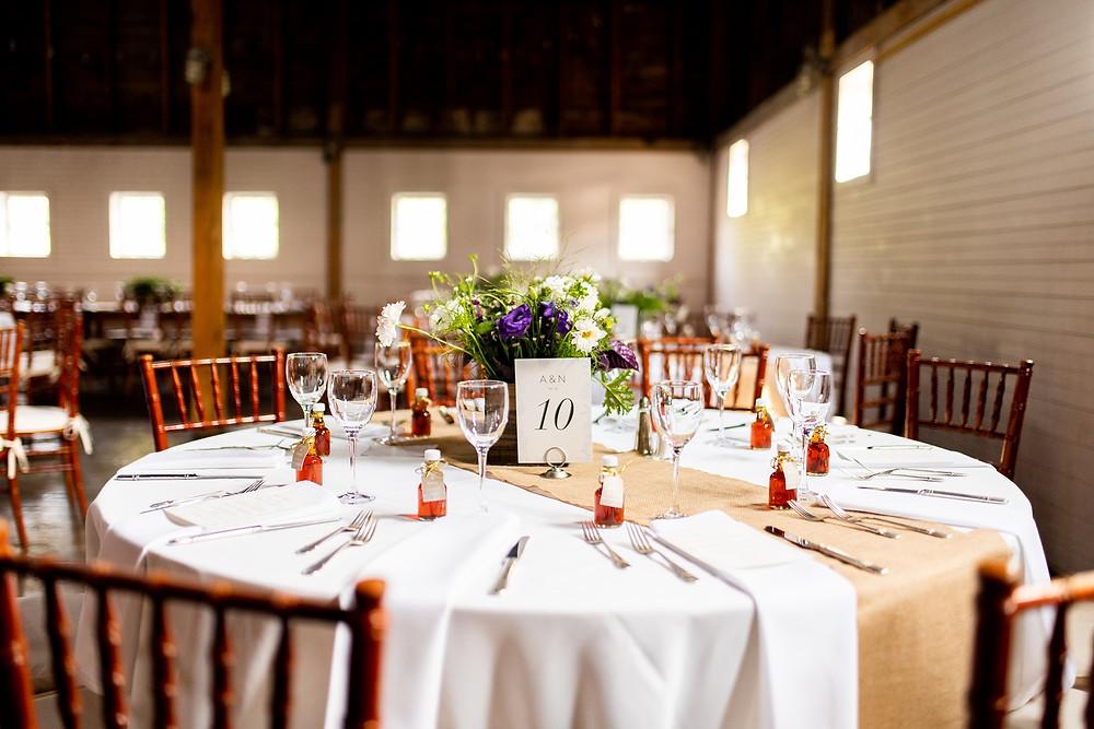 table setup at wedding reception in barn venue
