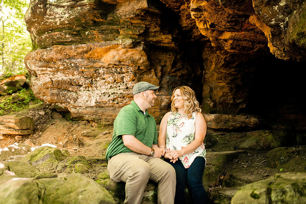 Man and woman sit and laugh with one another at Hinckley Reservation