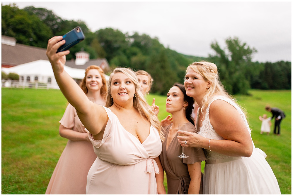 bridesmaids take a photo together after the ceremony