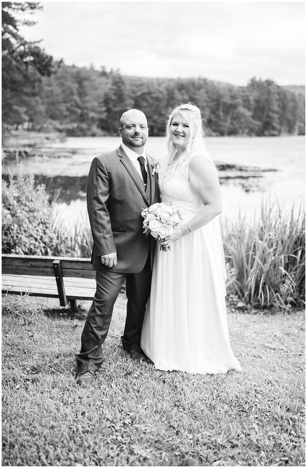 bride and groom portrait in front of vermont lake