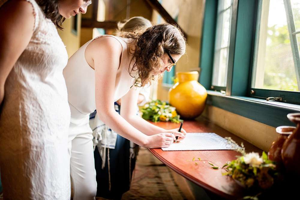 signing of the ketubah on their wedding day