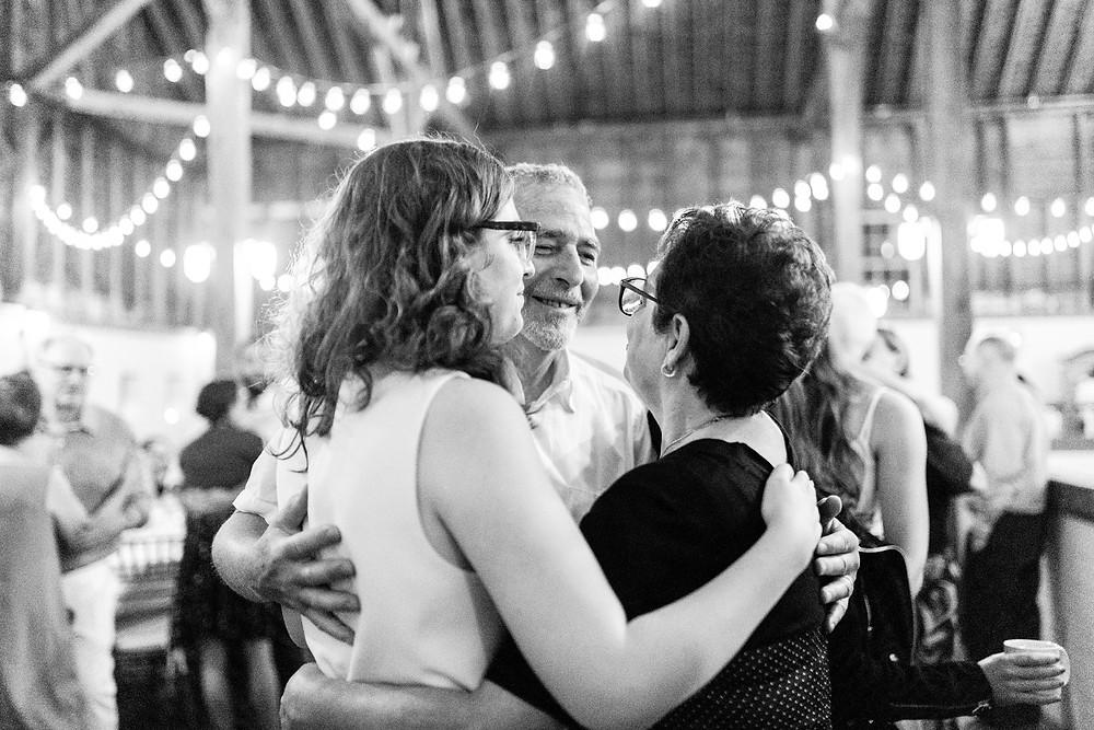 bride and parents embrace