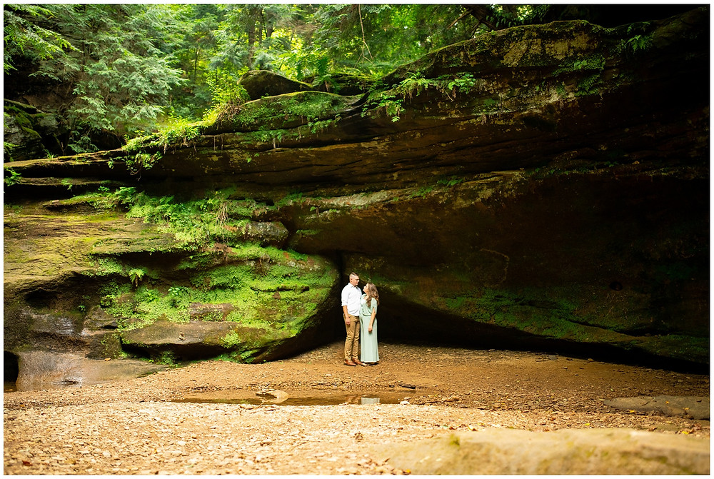 wide photo of man and woman's engagement session in hocking hills ohio