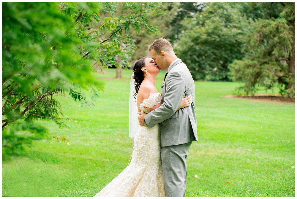Bride and groom kiss after first-look near Cleveland, Ohio