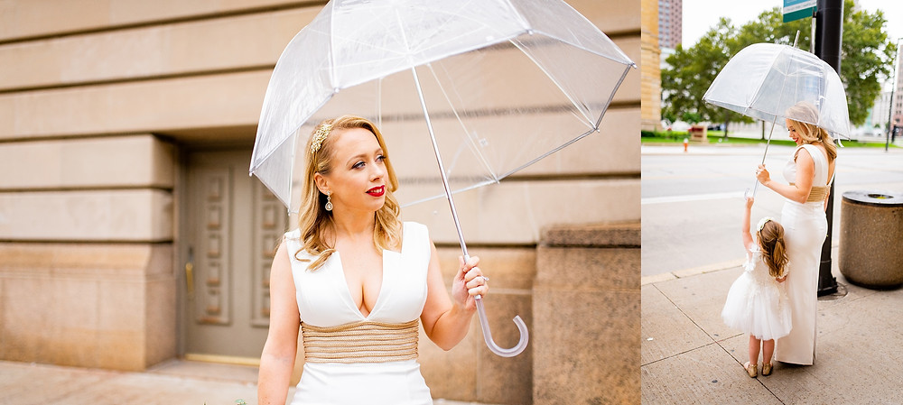 bride holds umbrella as they wait for the bus on their wedding day at westin cleveland