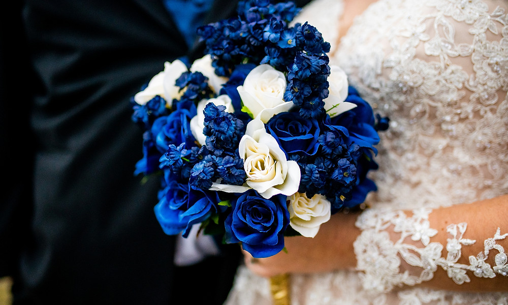 blue and white bridal bouquet for couple at edgewater park on wedding day in cleveland, ohio